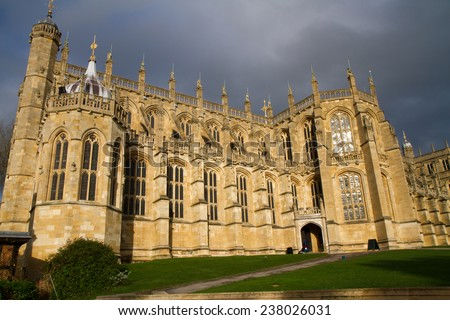 WINDSOR, ENGLAND - JANUARY 18: Outside view of Medieval Windsor Castle on january 18, 2014, Windsor, England. Windsor Castle is a royal residence at Windsor in the English county of Berkshire - stock photo