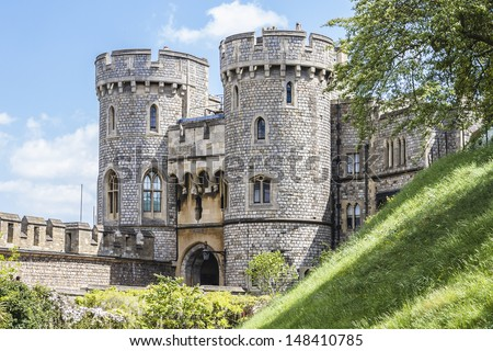 WINDSOR, ENGLAND - MAY 27: Outside view of Medieval Windsor Castle on May 27, 2013, Windsor, England. Windsor Castle is a royal residence at Windsor in the English county of Berkshire. - stock photo