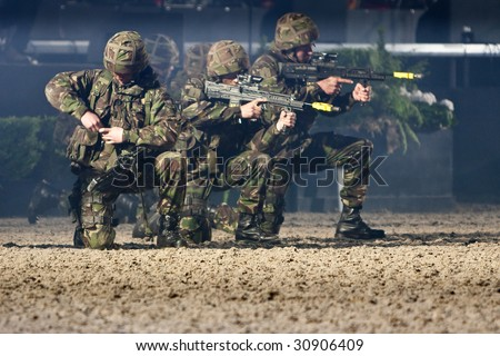 WINDSOR - MAY 16: Royal Marine Commandos in combat exercise at the Windsor Royal Tattoo on May 16, 2009 in Windsor, UK. - stock photo