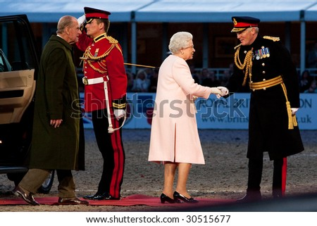 WINDSOR - MAY 16: The arrival of her Majesty Queen Elizabeth II and HRH The Duke of Edinburgh for The Royal Windsor Tattoo  on May 13, 2009 in Windsor, UK. - stock photo