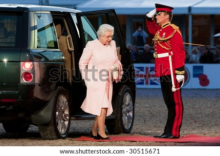 WINDSOR - MAY 16: The arrival of her Majesty Queen Elizabeth II for The Royal Windsor Tattoo  on May 13, 2009 in Windsor, UK. - stock photo