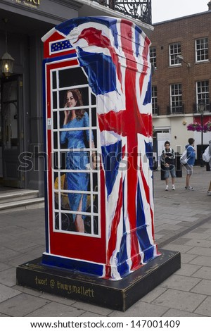 WINDSOR, UK - JULY 21: The Duchess of Cambridge depicted on Timmy Mallet's Ring a Royal Post Box. Art installation celebrating all things British, on July 21, 2013 in Windsor, UK. - stock photo