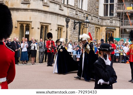 WINDSOR, UK- JUNE 13: Her Majesty Queen Elizabeth and Prince Phillip Duke of Edinburgh, in the robes of the Most Noble Order of the Garter. Garter Day at Windsor Castle June 13, 2011 in Windsor UK - stock photo