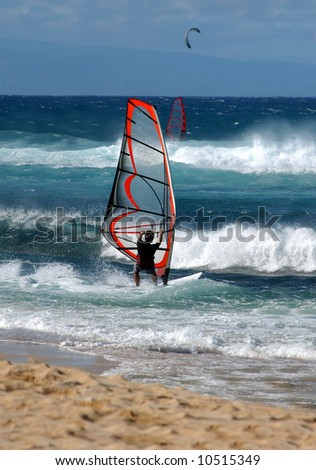 Windsurfer turns sailboard into the wind and heads out to sea.  Blue skies and water. - stock photo