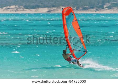Windsurfer windsurfing in the lagoon - stock photo