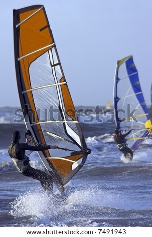 Windsurfers at the north sea in the Netherlands surfing