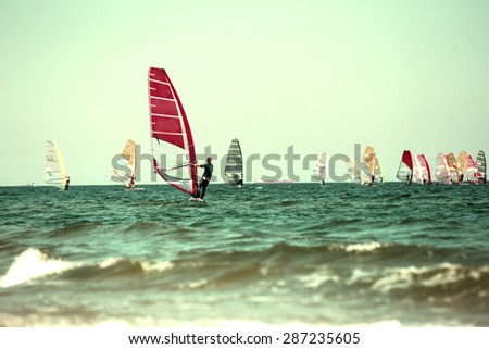 Windsurfers. Lomo effect - stock photo