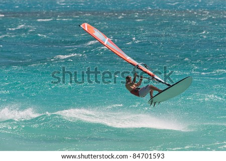 Windsurfing champion playing in the waves - stock photo