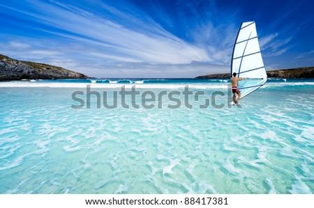 Windsurfing in beautiful waters - stock photo