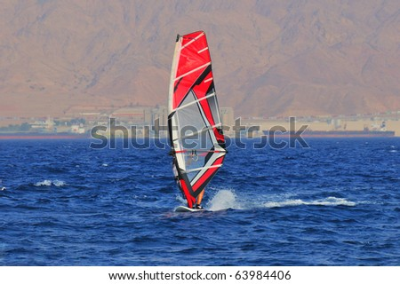 Windsurfing in the bay opposite the Jordanian Red Sea Mountains