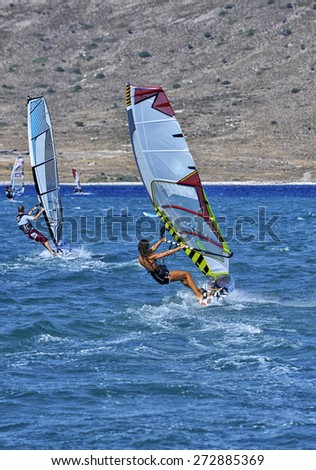Windsurfing in the blue waters of Alacati, Cesme, Turkey - stock photo