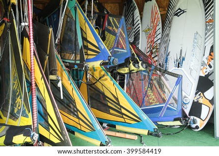 windsurfing water sports performed in the presence of wind torbolo Lake Garda Italy - stock photo