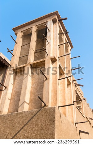 Windtower in the old merchant quarter of Bastakiya in Dubai, United Arab Emirates. It is iconic architectural symbols of Dubai and the UAE. - stock photo