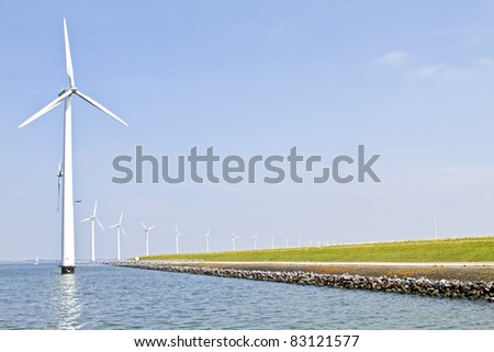 Windturbines at the IJsselmeer in the Netherlands - stock photo