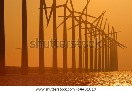 Windturbines with a sunset - stock photo