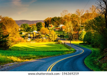 Windy country road in the Shenandoah Valley, Virginia. - stock photo