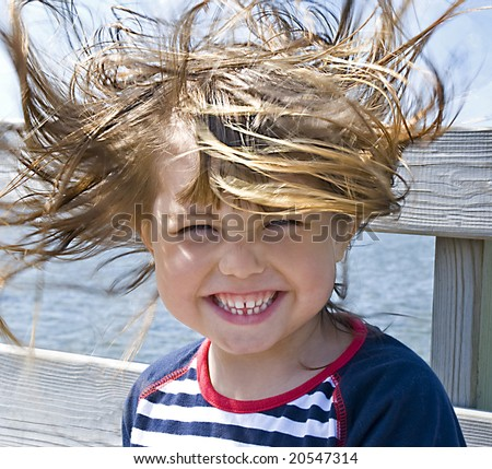 Windy hair, a girl on the beach when it blows hard - stock photo