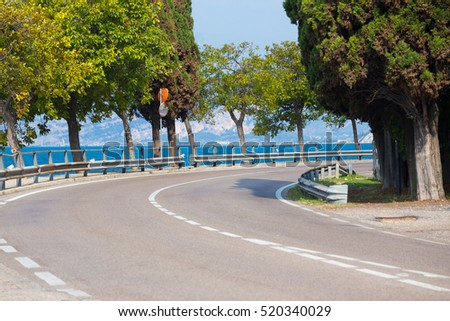windy road along Garda lake at the bright sunny day