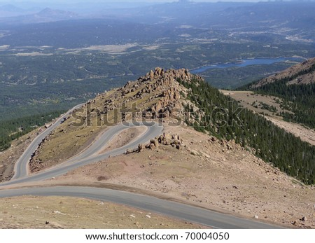Windy road up the Rocky Mountains. - stock photo