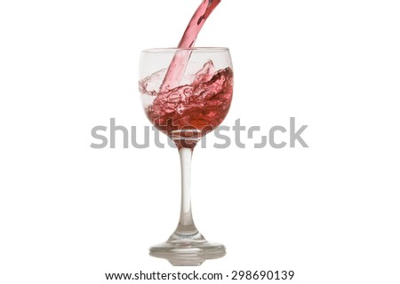 wine and a glass pouring on a white background - stock photo