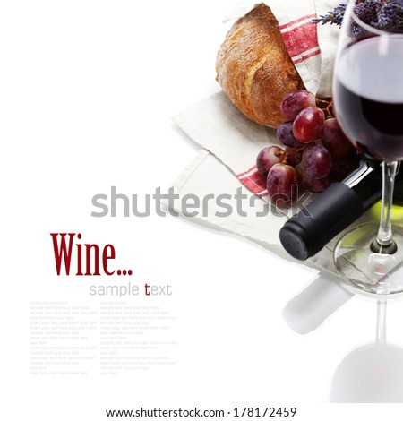 Wine and bread over white. With easy removable sample text - stock photo