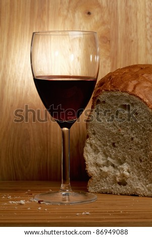 Wine and bread over wooden planks