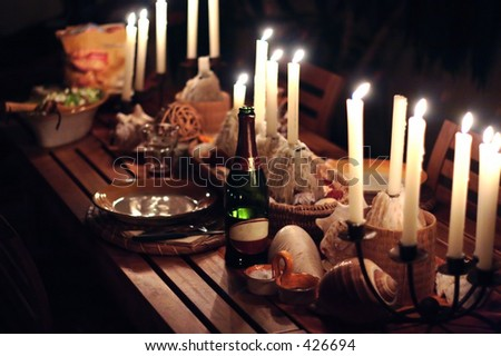 Wine and candles on dinner table - stock photo