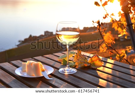 Wine and cheese against Geneva lake, Switzerland