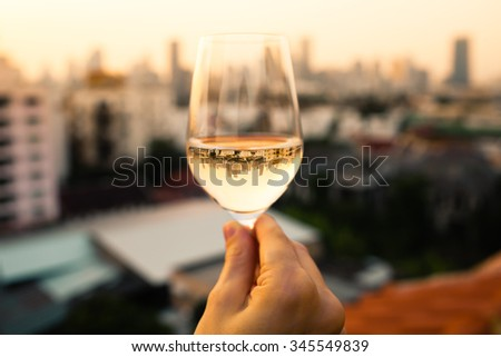 Wine and city view.  - stock photo