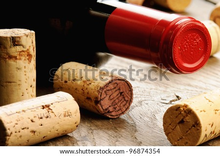 Wine and corks on wooden table - stock photo