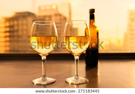 Wine and dine in the city. - stock photo