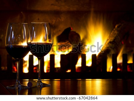 Wine and fireplace - stock photo