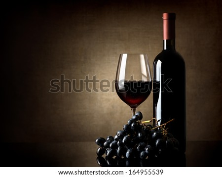 Wine and grape on a background of a canvas - stock photo