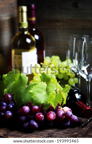 Wine and grape on wooden background - stock photo
