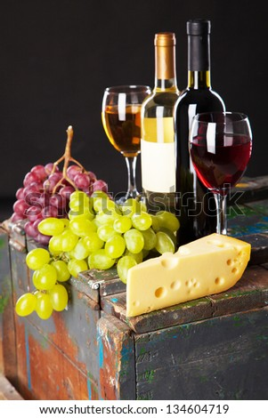Wine and grapes on a wooden table