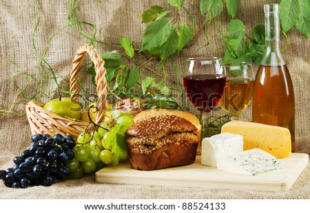 Wine and grapes on vintage background, studio photo
