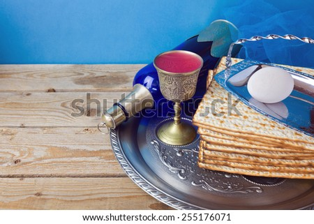 Wine and matzo for Jewish holiday Passover on wooden table - stock photo