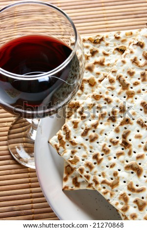 Wine and matzoh - elements of jewish passover supper - stock photo