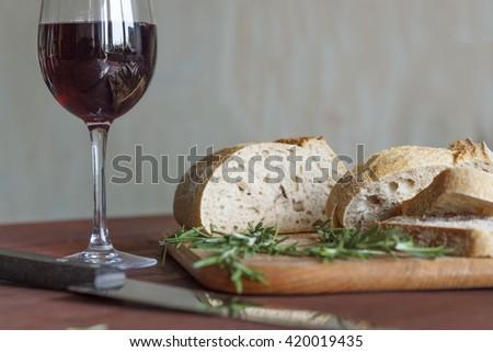 wine and snacks,Ciabatta bread and rosemary, top view, closeup. avocado and Arugula, closeup - stock photo