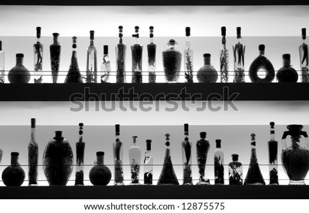 wine, and spices in colored bottles in a bar - stock photo