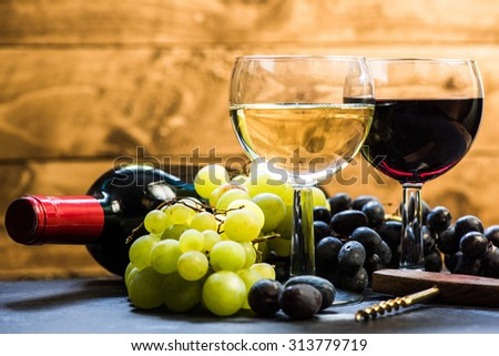 wine background, with grapes and bottle and vintage corkscrew - stock photo