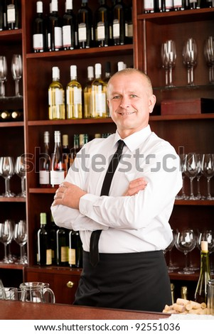 Wine bar waiter male in restaurant posing with cross arms - stock photo