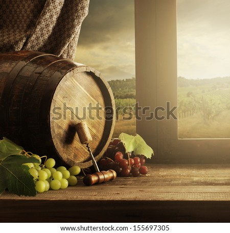 Wine barrel and grapes with vineyard on background - stock photo