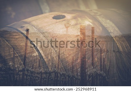 Wine Barrel and Vineyard Double Exposure outside in Retro Instagram Style - stock photo