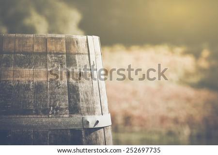Wine Barrel in Autumn with Retro Instagram Film Style - stock photo
