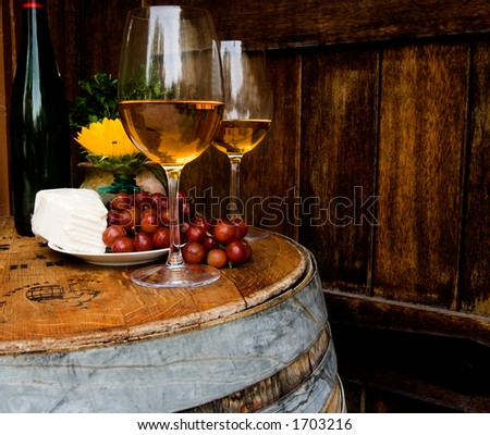 Wine barrel used as table for evening dining - stock photo