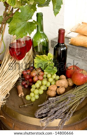 Wine barrel with fruits, red wine and bread - stock photo