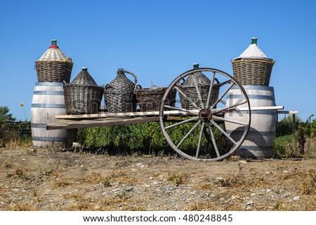 Wine Barrels and Bottles in Baskets on a Wagon