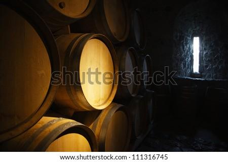 Wine barrels in a old wine cellar - stock photo