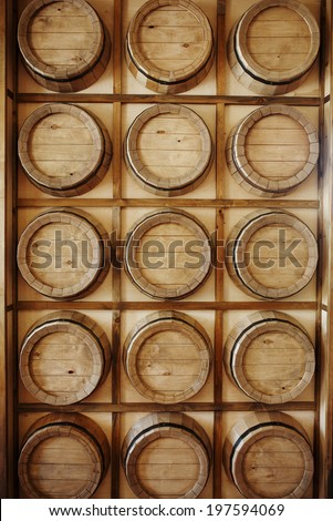 Wine barrels in a old wine cellar. Vertical - stock photo
